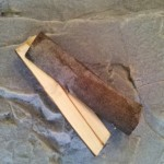 """Step # 1: Split a 3"""" diameter branch in half. Seasoned wood is preferred."""