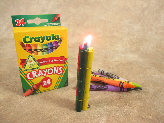Three crayons tied together makeshift diy survival candle.