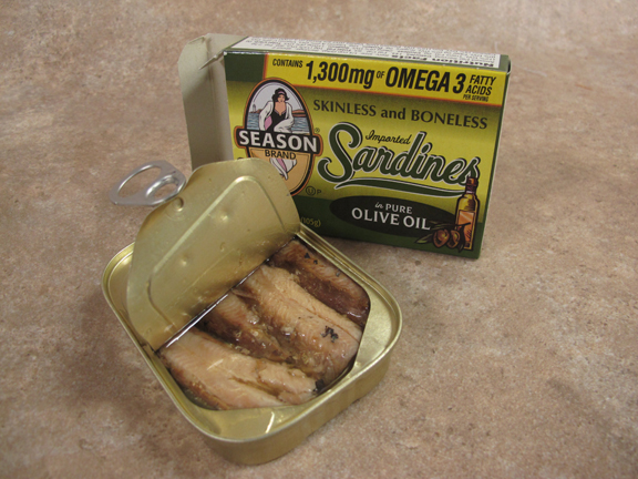 Open can tin of sardines in olive oil makeshift candle.
